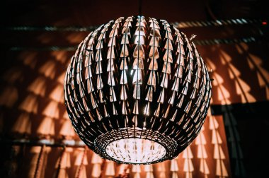 Chandelier in a night club. Chandelier in the shape of a ball.