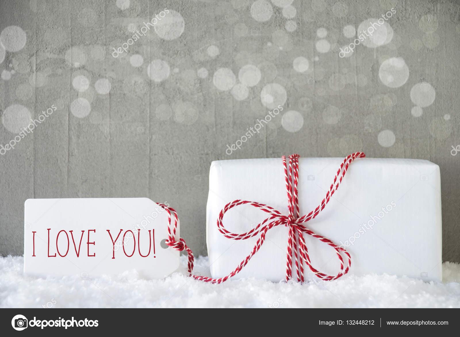 Geschenk, Zement-Hintergrund mit Bokeh, Text ich liebe dich ...