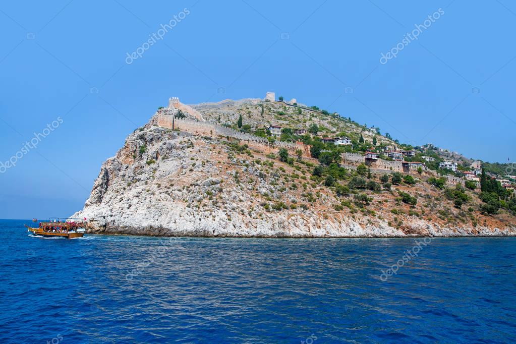 Ship on the water of Mediteranean sea, Ship traveling around Alanya castle