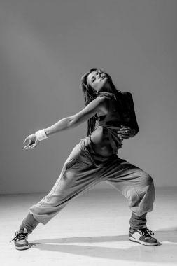 Young beautiful woman breakdancer posing in studio stock vector