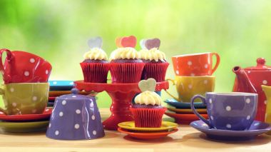 Colorful Mad Hatter style tea party with cupcakes