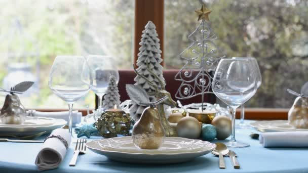 Stylish blue, gold and white Christmas table