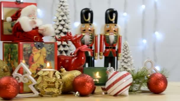 Festive Christmas ornaments with vintage Santa music box.