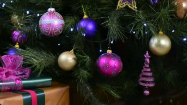 christmas tree with jewel color decorations with twinkling lights stock video - Jewel Colored Christmas Decorations