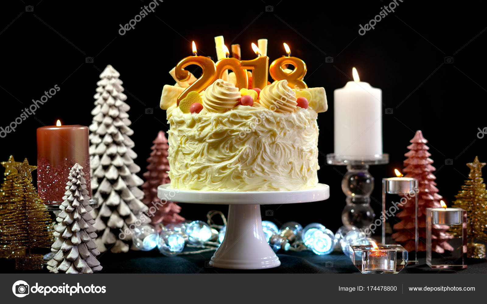 2018 happy new year showstopper cake decorated with white chocolate frosting cookies and candy centerpiece on a festive table photo by amarosy