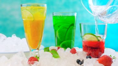 Preparing Summer Spritzer drinks with fresh fruit with sparkling mineral water.