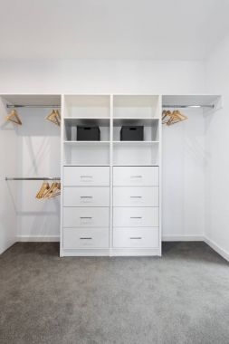 White built in storage in walk in wardrobe