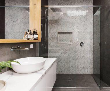 Marble mosaic herringbone tiled shower