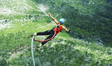 Rope jumping.Jump off a cliff into a canyon with a rope.