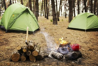 Camping in the forest. Preparation of breakfast at the stake.