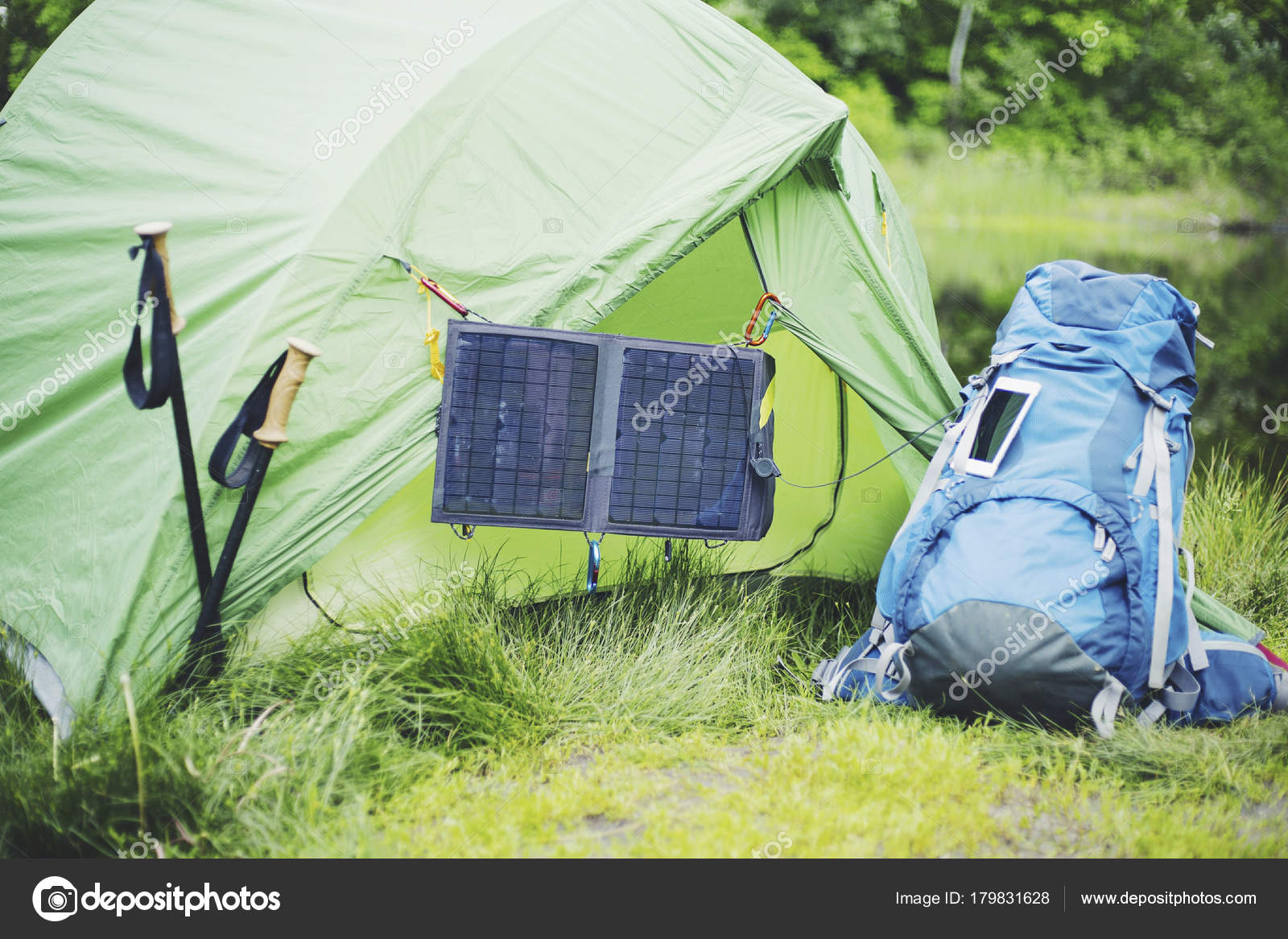 The solar panel hangs on the tent. u2014 Photo by vetal1983 & Camping on the river bank. The solar panel hangs on the tent ...