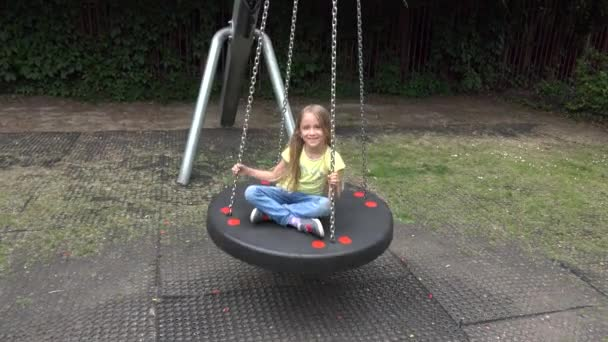 Kid Swinging Outdoor, Child Playing at Playground, Happy Smiley Girl Plays in Park, Children Outdoor