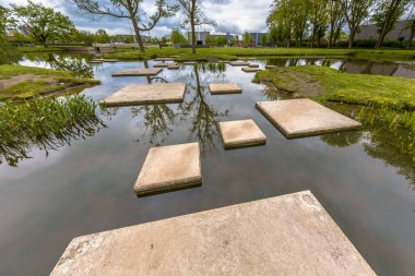 Labyrinth of Stepping stones in pond
