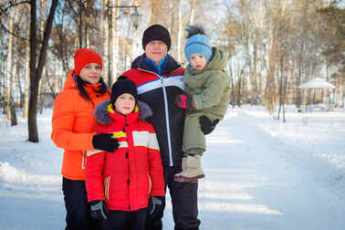 family spending time outdoor in winter