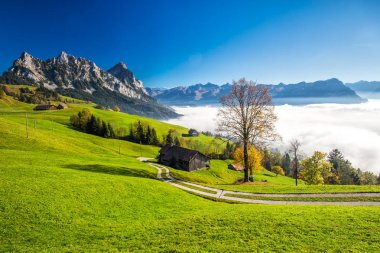 Fog surrounding Grosser and Kleiner Mythen in Swiss Alps