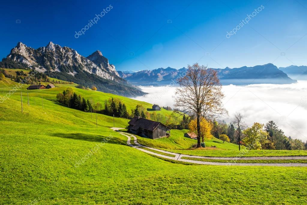 Fog surrounding Grosser and Kleiner Mythen in Swiss Alps