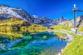 Photo Crystal clear Melchsee and Swiss Alps panorama from Melchsee Frutt