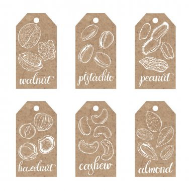 Collection of kraft paper tags with nuts.