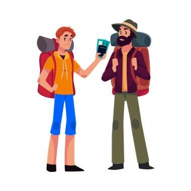 Two man travelling, hitchhiking with backpacks and ticket
