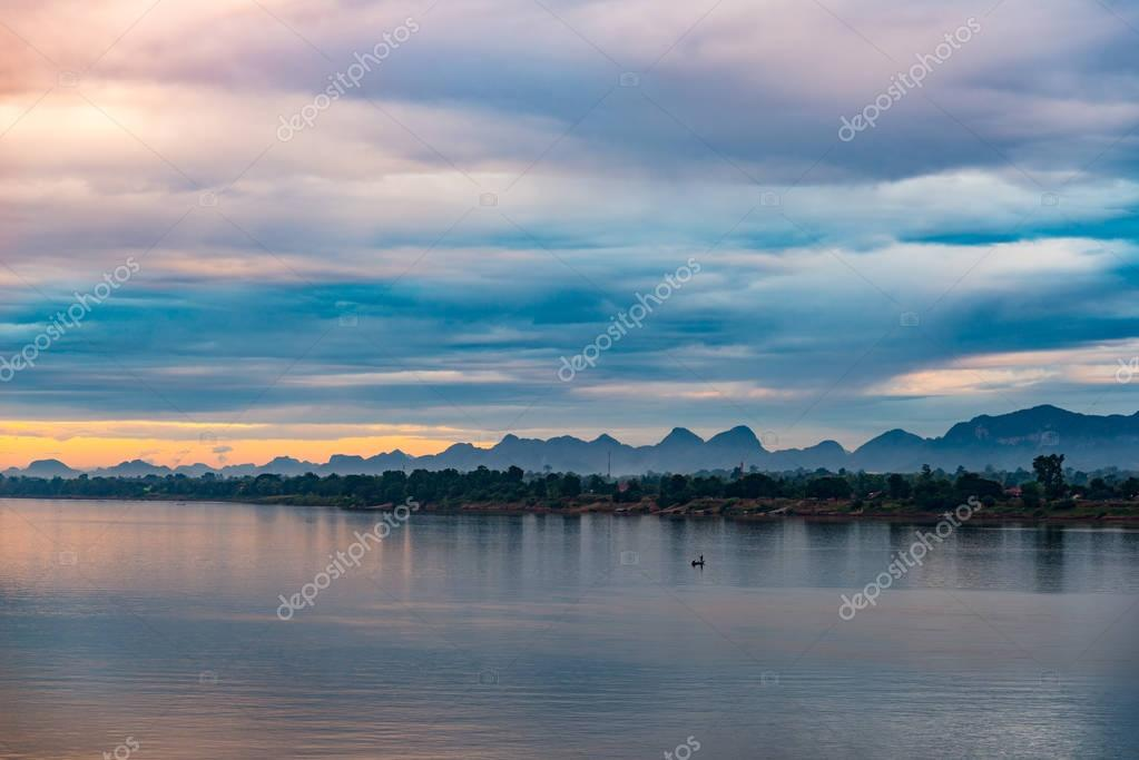 Stunning landscape in Lao PDR on the opposite Mekong river bank, viewed from Nakhon Phanom. Outstanding cloudscape at dusk.