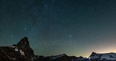 starry sky Time Lapse over the majestic Matterhorn Cervino mountain peak and the Monte Rosa glaciers, italian side.