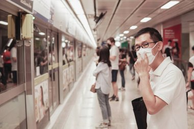 Middle aged Asian man wearing glasses and medical face mask,  Wu