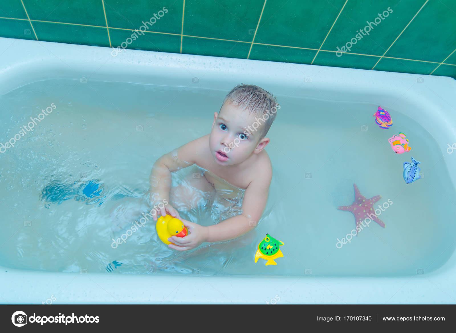 Boy in white bath tub on white background — Stock Photo © volniy ...