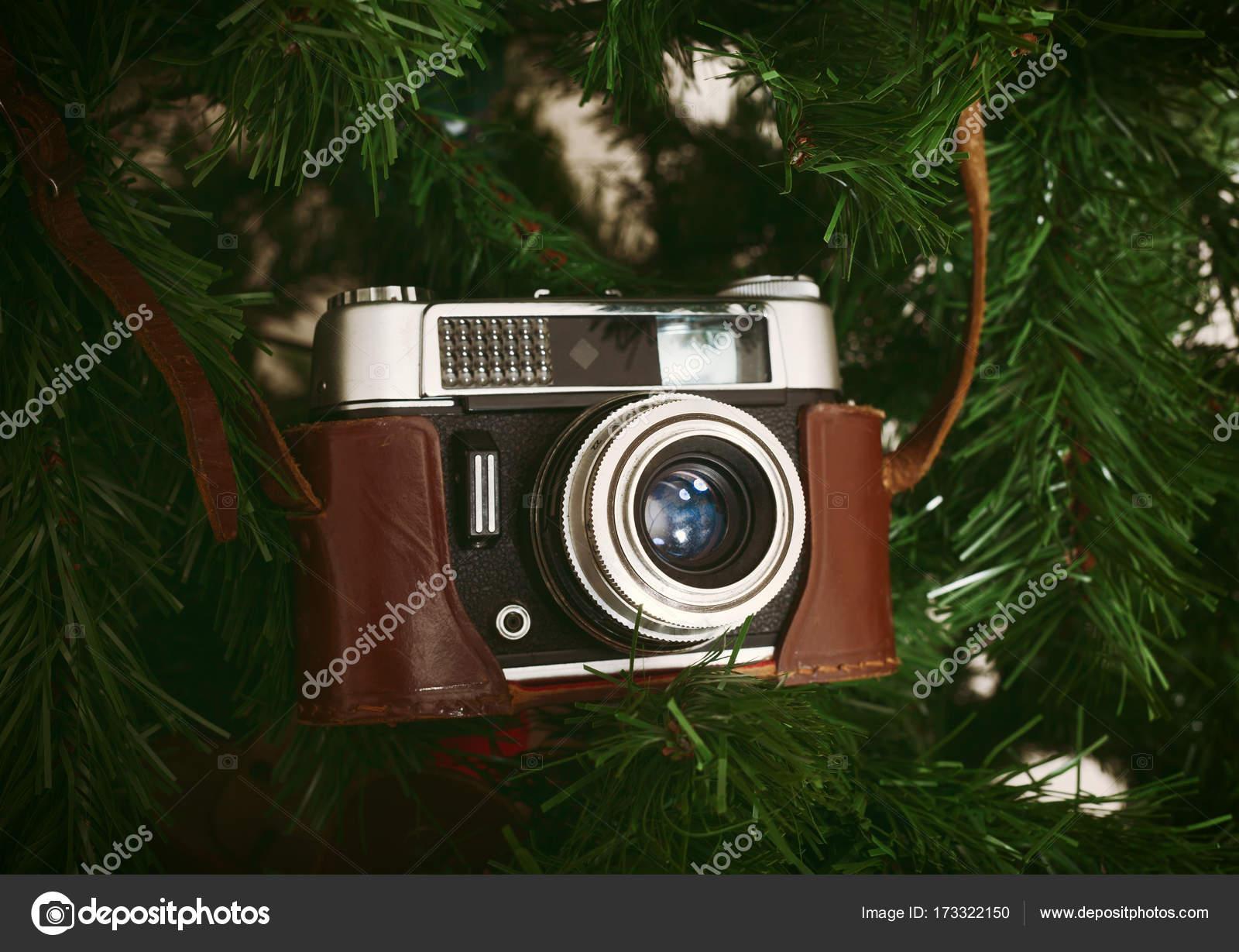 Vintage Artificial Christmas Trees.Vintage Camera Hanging On Artificial Christmas Tree Stock Photo