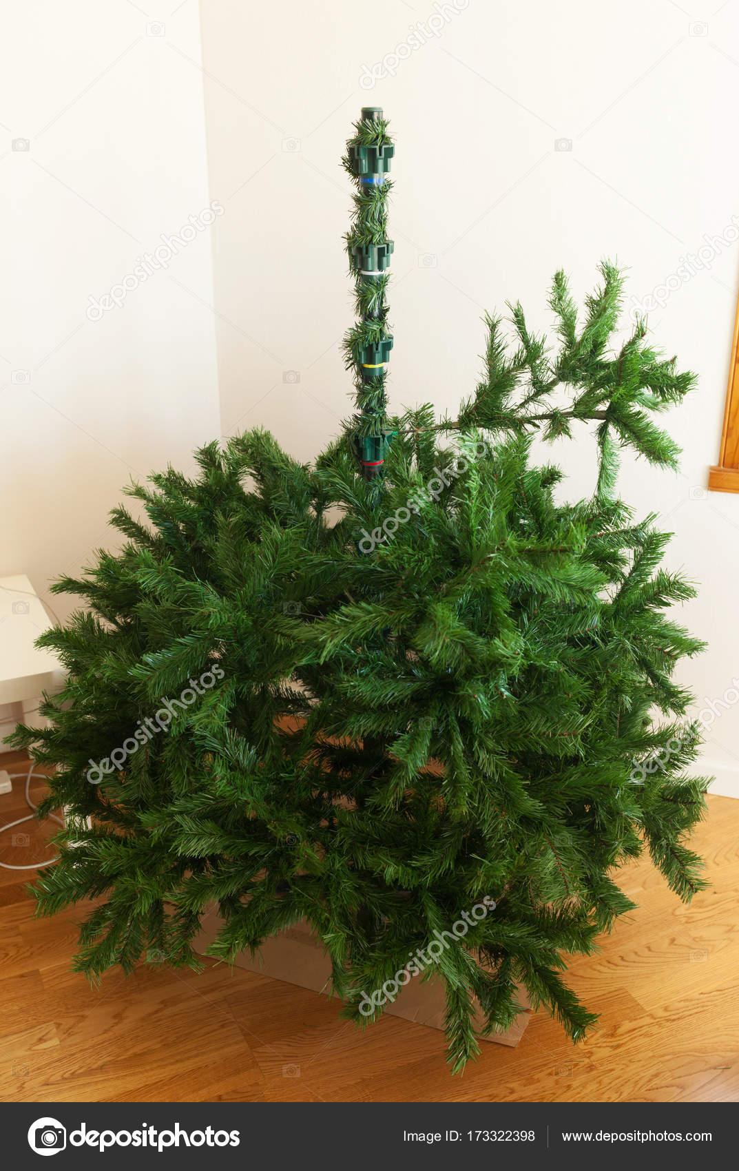 Mounting artificial Christmas tree — Stock Photo © AntonioGravante ...