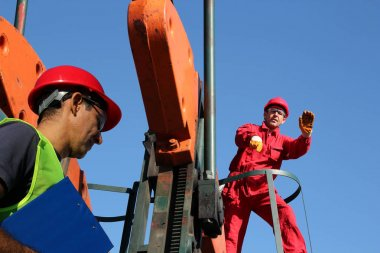 Oilfield Workers at Oil Well