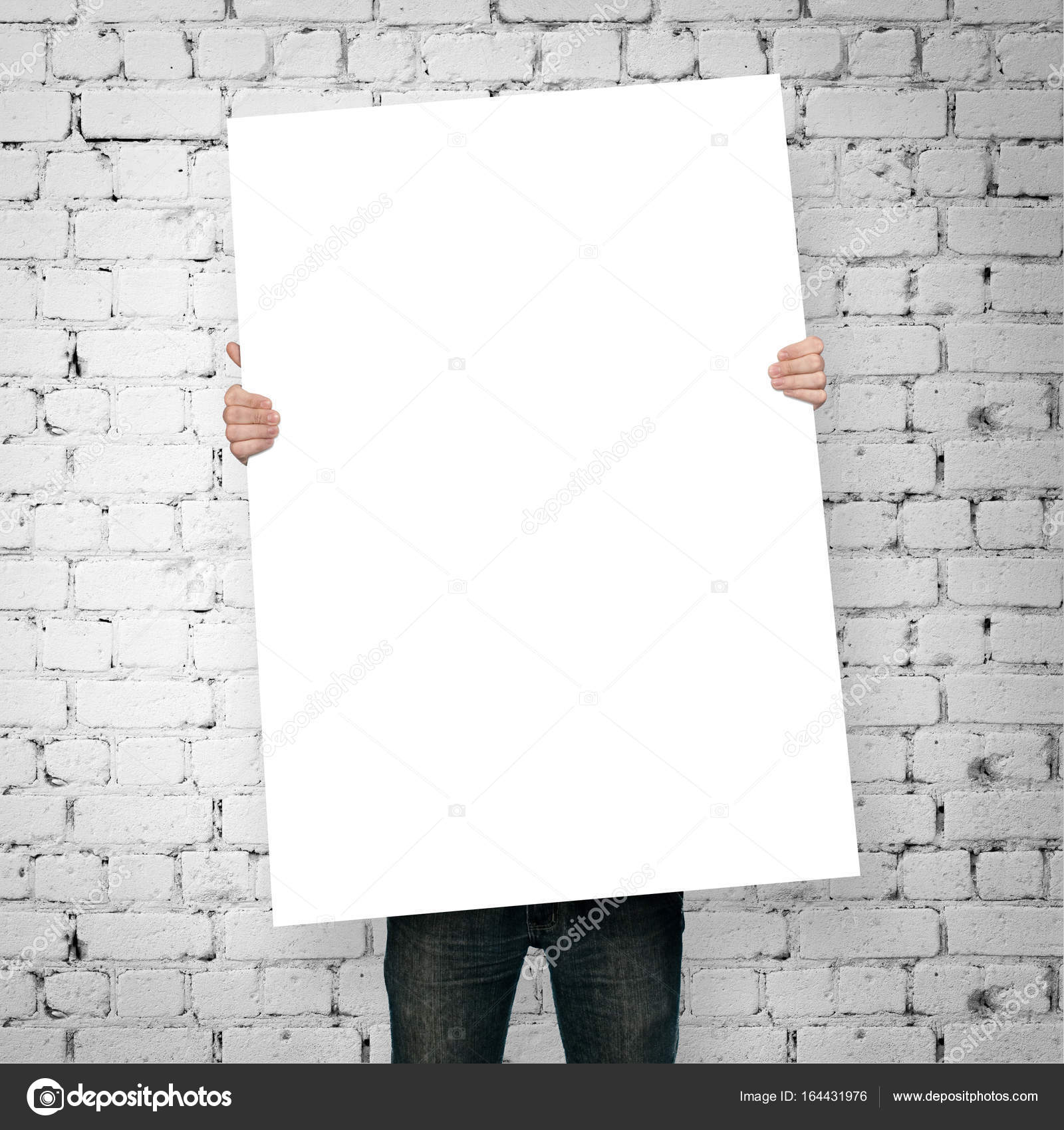 Man Holding Blank Poster On Stock Photo