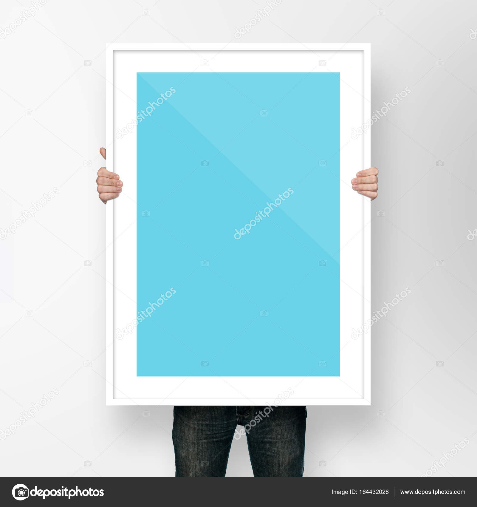 man holding poster mockup template with frame on white background