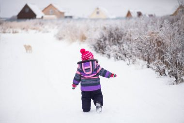 Baby runing outdoors, snowy winter