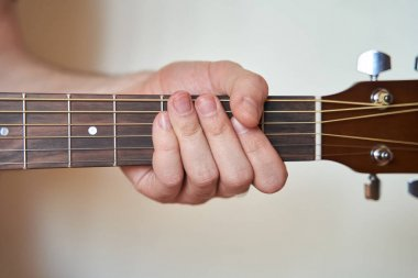 Musician Hand on Acoustic Guitar. Close up
