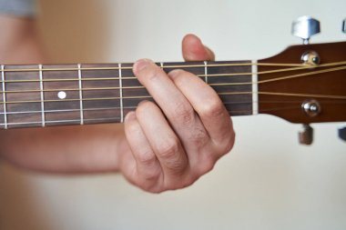 Musician Hand in G Major Chord on Acoustic Guitar