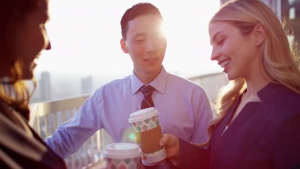 executives drinking coffee