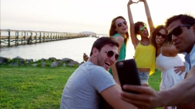People taking a photo on mobile