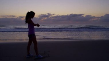 woman with a healthy lifestyle by ocean