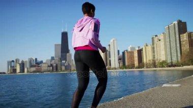 female  running  by shoreline