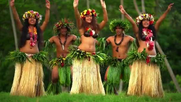 men with girls dancing hula