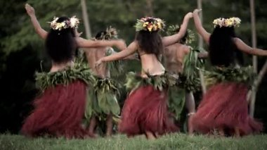 men with girls dancing hula