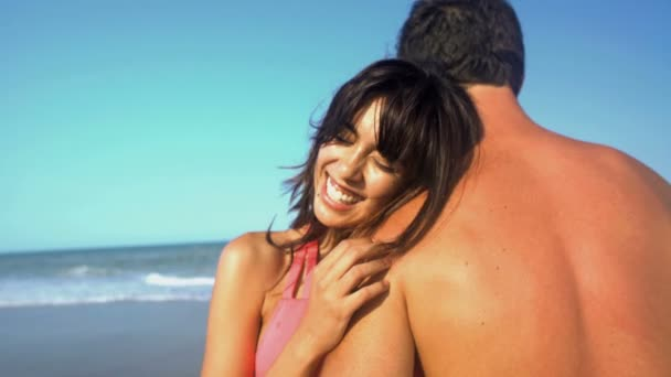 woman with man relaxing on beach