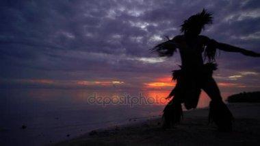 Polynesian warrior dancer entertaining in costume