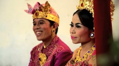 bride and groom attending the marriage ceremony