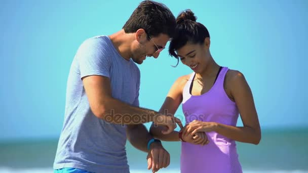 couple using sport watches