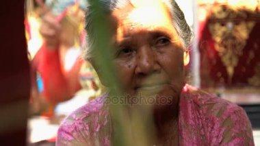 Balinese senior  female waiting for family