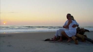 couple enjoying sunrise on beach