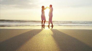 seniors dancing on the beach