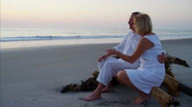 seniors on beach sunset