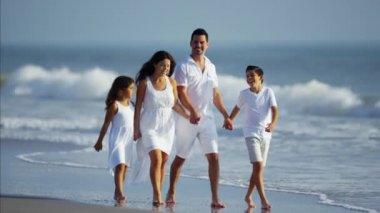 family spending time by ocean